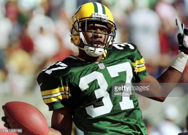 Green Bay Packers' cornerback Tyrone Williams celebrates his interception off Arizona Cardinals' quarterback Jake Plummer during the fourth quarter...