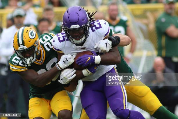 Green Bay Packers defensive back Darnell Savage tries to strip the ball from Minnesota Vikings running back Alexander Mattison during a game between...