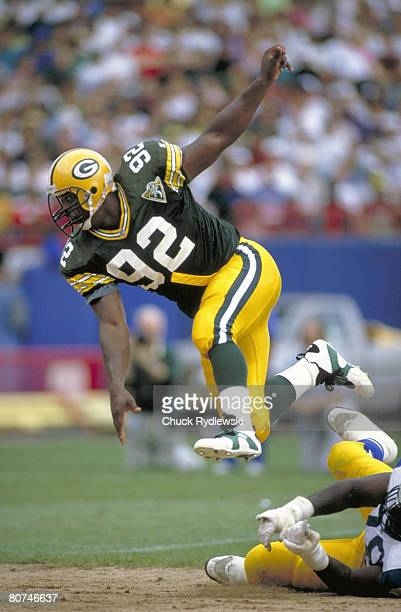 Green Bay Packers Defensive End Reggie White rushes the QB during a 1994 game against the Los Angeles rams at County Stadium in Milwaukee Wisconsin