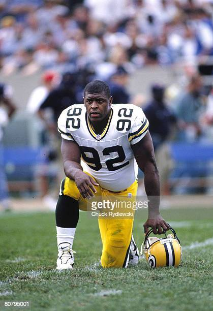 Green Bay Packers Defensive End Reggie White takes a breather during the 1997 game against the Chicago Bears at Soldier Field in Chicago Illinois