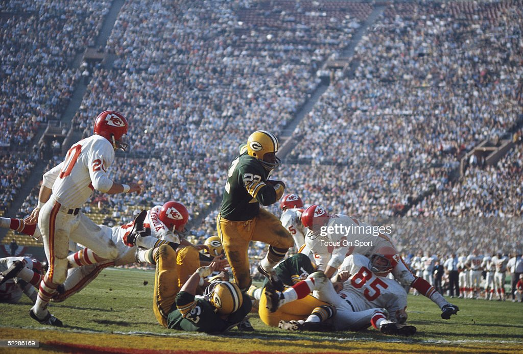 Green Bay Packers' Elijah Pitts #22 runs with the ball during Super Bowl I against the Kansas City Chiefs at Memorial Coliseum on January 15, 1967 in Los Angeles, California. The Packers defeated the Chiefs 35-10.