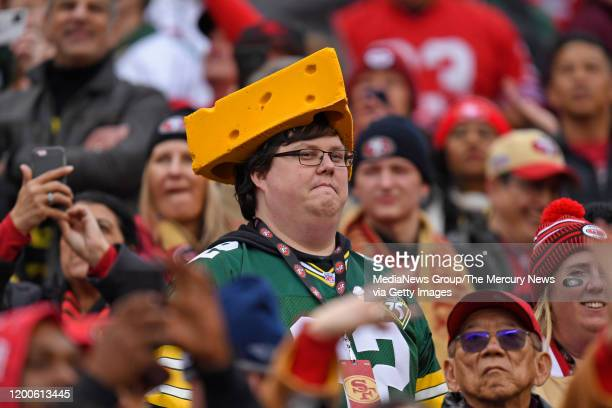 Green Bay Packers fan appears uncomfortable while surrounded by San Francisco 49ers fans in the first quarter of their NFC Championship game at...