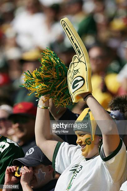 Green Bay Packers fan cheers during the game against the St Louis Rams at Lambeau Field on October 8 2006 in Green Bay Wisconsin The Rams defeated...
