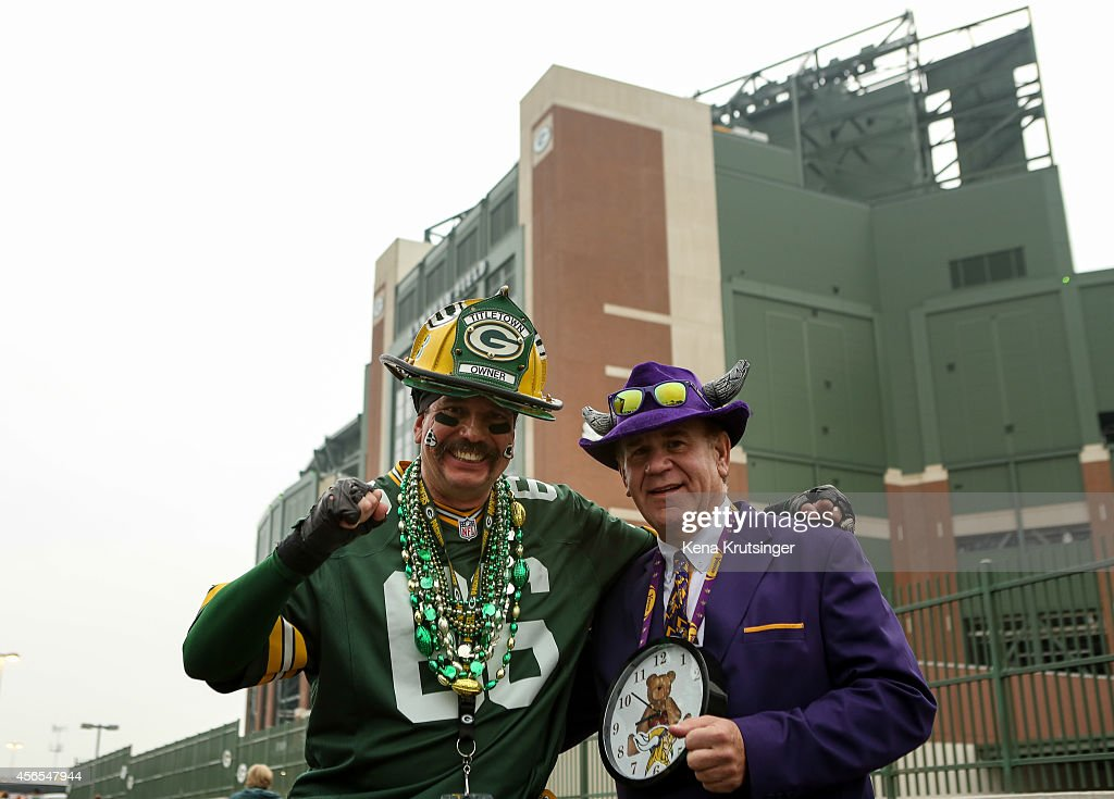 Green Bay Packers fan, Don Hays from LA, and Minnesota Vikings fan Bob Arts from Anchorage AK, pose for a photo prior to the NFL game on October 02, 2014 at Lambeau Field in Green Bay, Wisconsin.