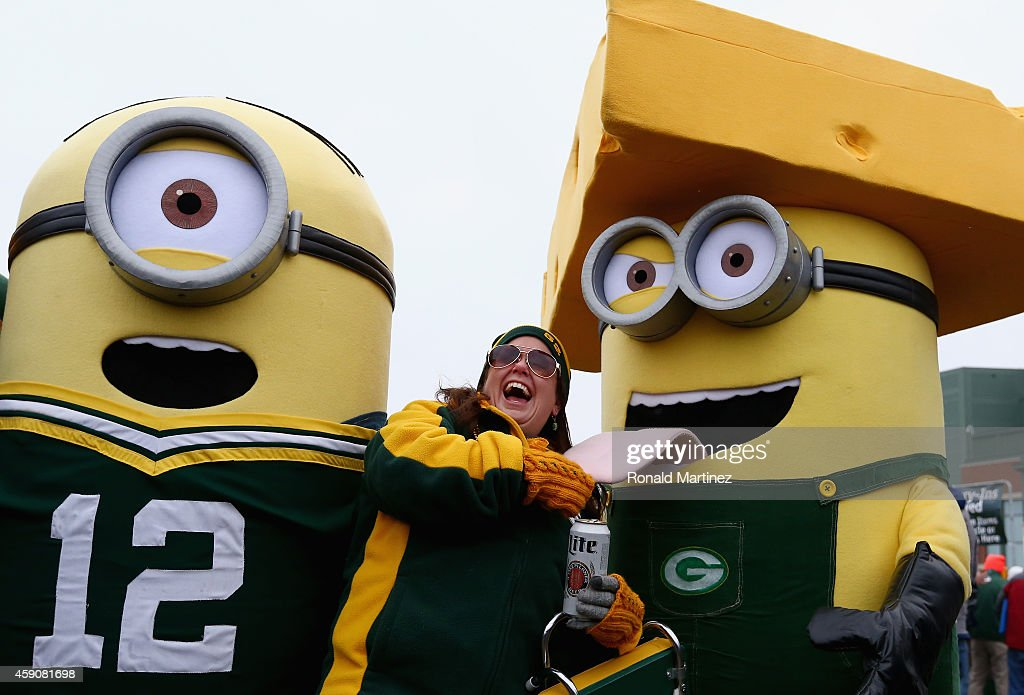 A Green Bay Packers fan smiles with two Minions dressed in Greenbay attire before the game against the Philadelphia Eagles outside of Lambeau Field on November 16, 2014 in Green Bay, Wisconsin.