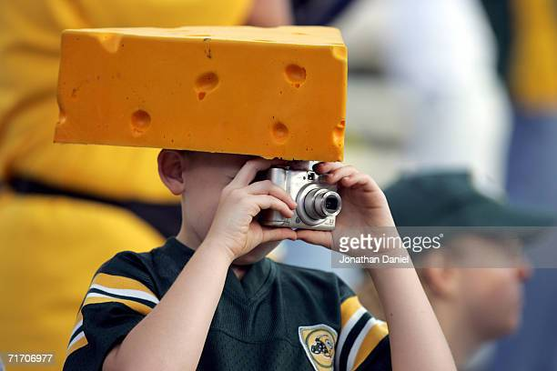 Green Bay Packers fan takes a photograph during the preseason game against the Atlanta Falcons on August 19 2006 at Lambeau Field in Green Bay...