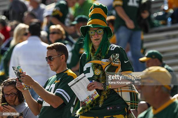 Green Bay Packers fan watches from the stands prior to the NFL game against the New York Jets on September 14 2014 at Lambeau Field in Green Bay...