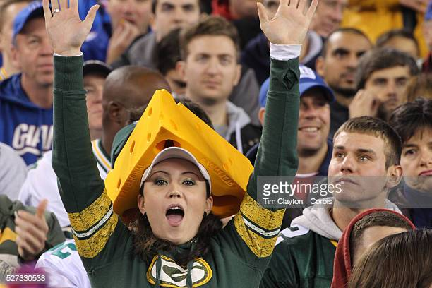 A Green Bay Packers fan wearing a cheesehead hat during the New York Giants Vs Green Bay Packers NFL American Football match at MetLife Stadium East...