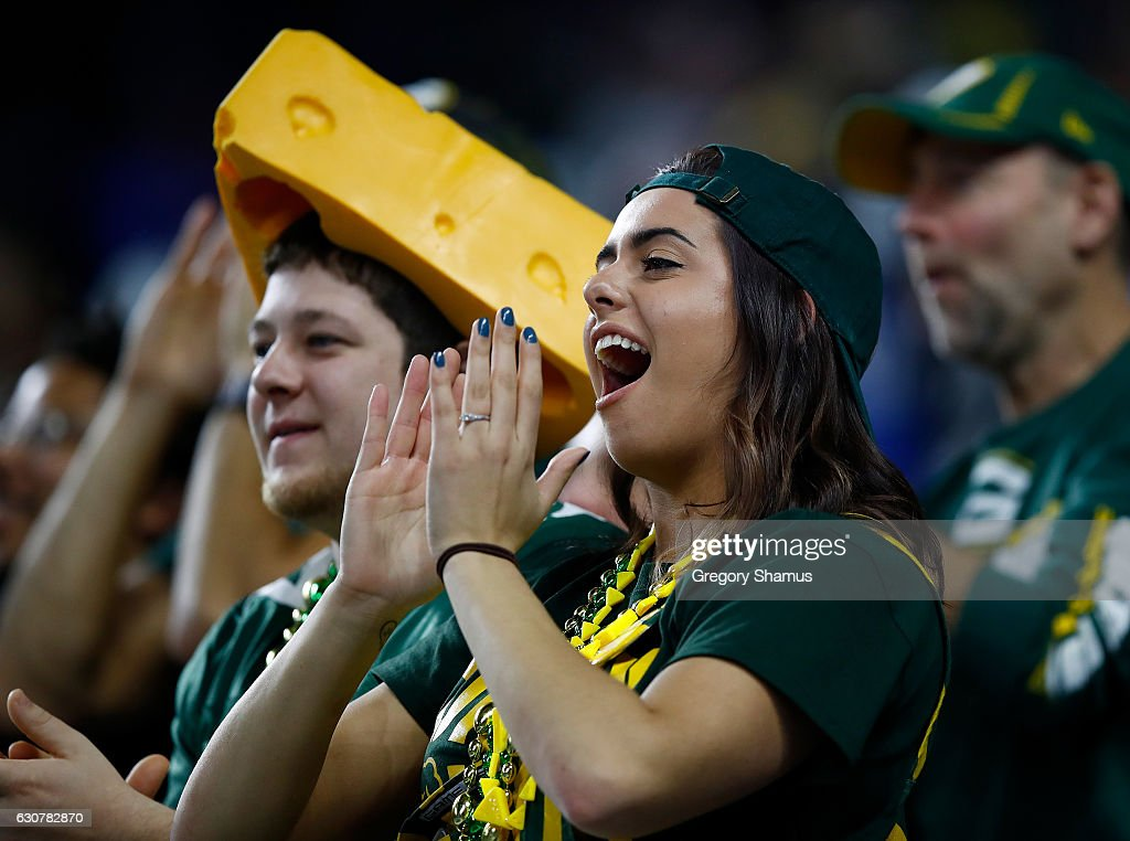 Green Bay Packers fans celebrate a 31-24 win over the Detroit Lions at Ford Field on January 1, 2017 in Detroit, Michigan.