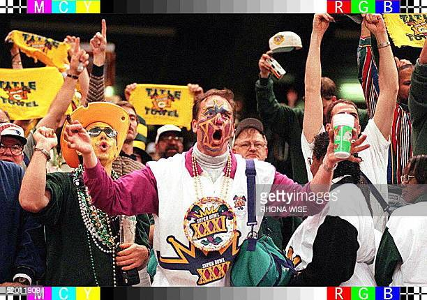 Green Bay Packers fans celebrate in the stands after Green Bay won Super Bowl XXXI at the Louisiana Superdome in New Orleans 26 January Green Bay...