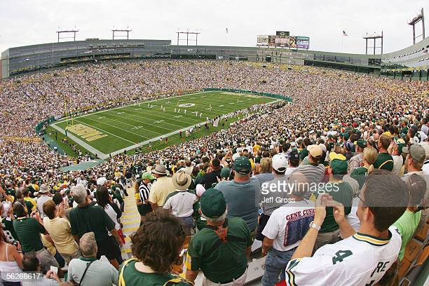 Green Bay Packers fans cheer from the stands against the Cleveland Browns at Lambeau Field on September 18 2005 in Green Bay Wisconsin The Browns...