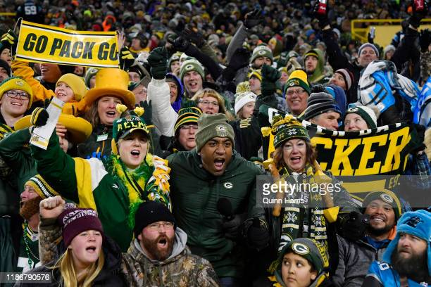 Green Bay Packers fans cheer in the first half of the game against the Carolina Panthers at Lambeau Field on November 10 2019 in Green Bay Wisconsin