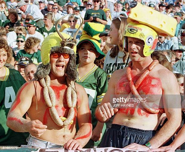 Green Bay Packers fans Jesse Buechel and TJ Schmitz dress in bratwurst for the New England Patriots vs Green Bay Packers 31 July at Lambeau Field in...