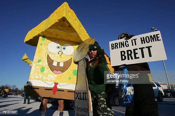 Green Bay Packers fans pose with a Sponge Bob cheesehead character before the NFC championship game against the New York Giants on January 20 2008 at...
