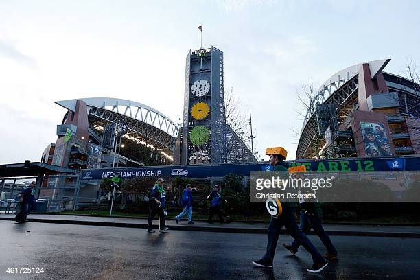 Green Bay Packers fans walk by the exterior of CenturyLink Field before the 2015 NFC Championship game between the Seattle Seahawks and the Packers...