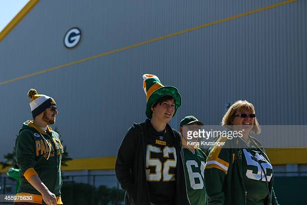 Green Bay Packers fans walk to Lambeau Field prior to the NFL game against the New York Jets on September 14 2014 in Green Bay Wisconsin The Packers...