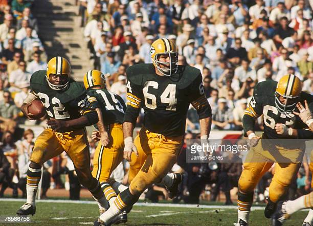 Green Bay Packers guard Jerry Kramer leads the blocking for running back Elijah Pitts during Super Bowl I a 3510 victory over the Kansas City Chiefs...