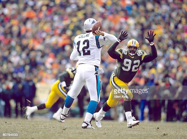 Green Bay Packers Hall of Fame defensive end Reggie White closes in on Carolina Panthers quarterback Kerry Collins during the NFC Championship Game a...