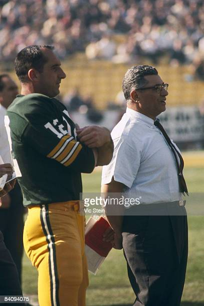 Green Bay Packers Hall of Fame head coach Vince Lombardi adn backup quarterback Zeke Bratkowski watch the team warm up before Super Bowl I a 3510...