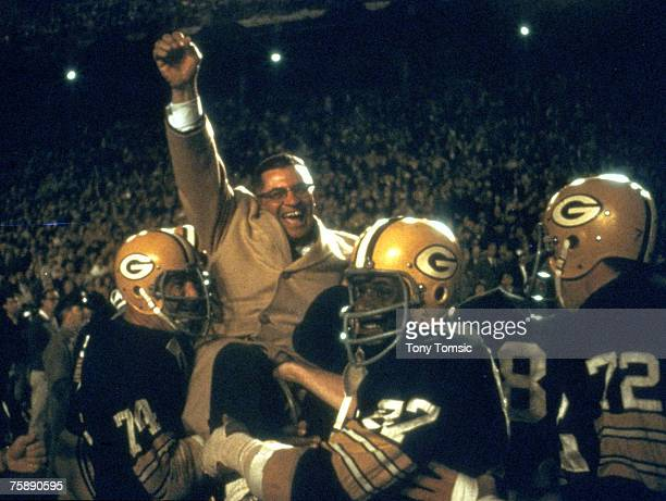 Green Bay Packers Hall of Fame head coach Vince Lombardi is carried off the field by his players after a 34-27 win over the Dallas Cowboys in the...