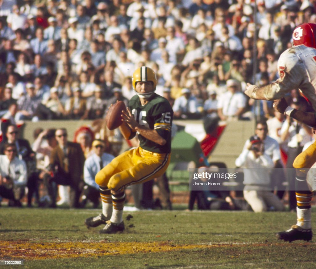 Green Bay Packers Hall of Fame quarterback Bart Starr (15) settles in the pocket during Super Bowl I, a 35-10 victory over the Kansas City Chiefs on January 15, 1967, at the Los Angeles Memorial Coliseum in Los Angeles, California.