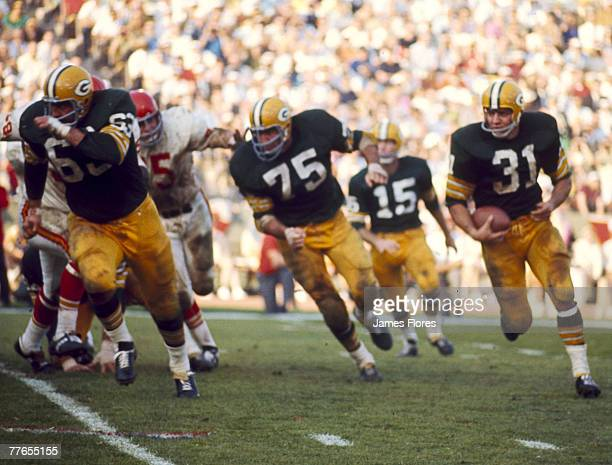 Green Bay Packers Hall of Fame running back Jim Taylor carries the ball in the famed Green Bay sweep against the Kansas City Chiefs in the Packers'...