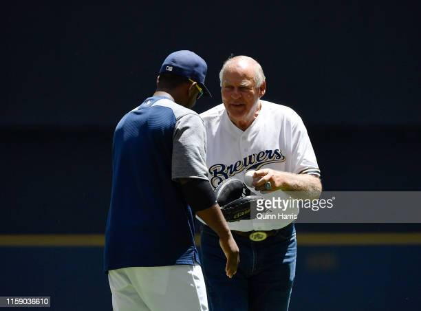 Green Bay Packers hall of famer Jerry Kramer throws a ceremonial first pitch before the game between the Milwaukee Brewers and the Seattle Mariners...