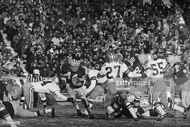 12/31/67NFL CHAMPIONSHIP Green Bay Packers HB Donny Anderson drives 9yards through Dallas line during 1st quarter of NFL Championship game with...
