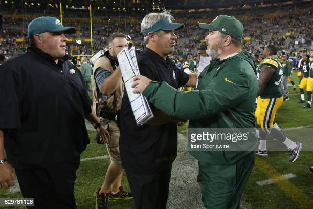 Green Bay Packers head coach Mike McCarthy and Philadelphia Eagles head coach Doug Pederson shake hands during a football game between the Green Bay...