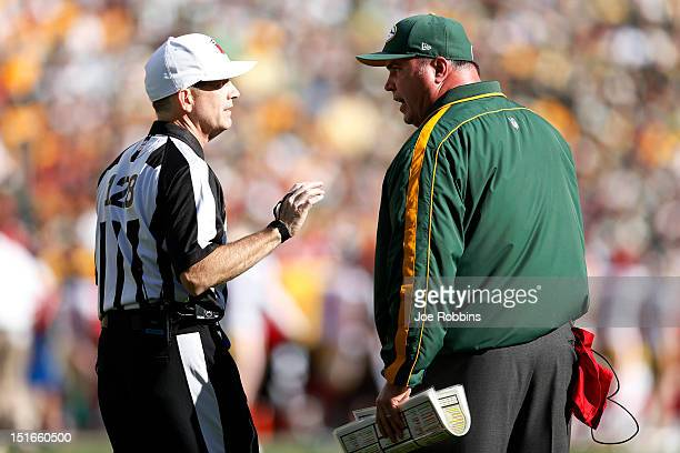 Green Bay Packers head coach Mike McCarthy argues with an official during the first half of the game against the San Francisco 49ers at Lambeau Field...