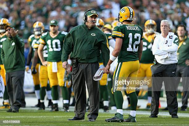 Green Bay Packers head coach Mike McCarthy speaks with quarterback Aaron Rodgers in the third quarter during the NFL game against the New York Jets...