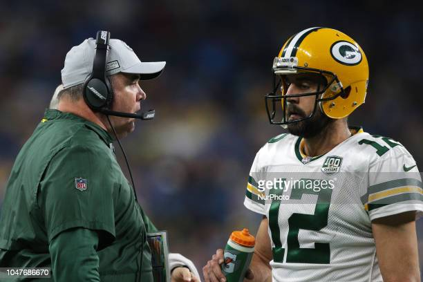 Green Bay Packers head coach Mike McCarthy talks to quarterback Aaron Rodgers during the second half of an NFL football game against the Detroit...