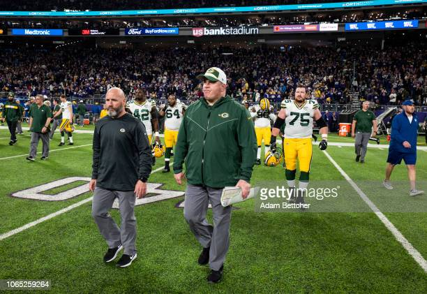 Green Bay Packers head coach Mike McCarthy walks on the field after the game against the Minnesota Vikings at US Bank Stadium on November 25 2018 in...