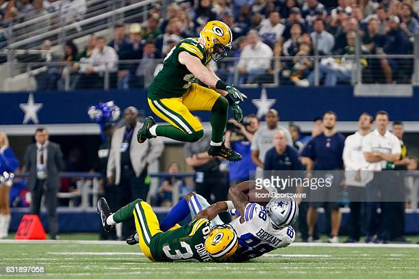 Green Bay Packers inside linebacker Jake Ryan leaps over Dallas Cowboys wide receiver Dez Bryant who's tackled by cornerback LaDarius Gunter during...