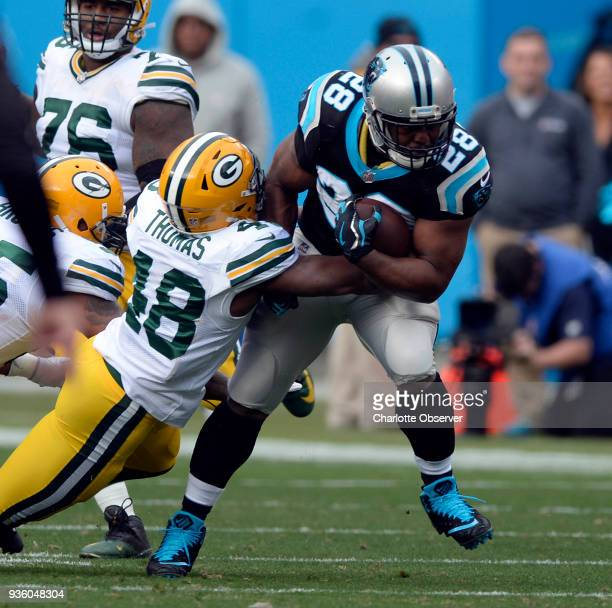 Green Bay Packers inside linebacker Joe Thomas hits Carolina Panthers running back Jonathan Stewart on December 17 at Bank of America Stadium in...