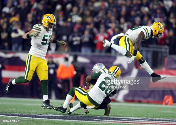 Green Bay Packers' Kentrell Brice sails over New England Patriots' Josh Gordon after a reception during the third quarter The New England Patriots...