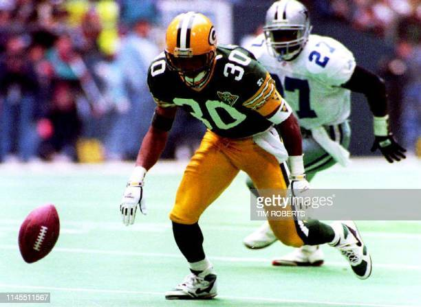 Green Bay Packers kick returner Corey Harris scrambles to recover his own fumble just 23 seconds before the half 16 January 1994 Dallas recovered the...