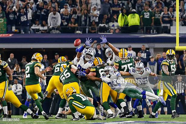 Green Bay Packers kicker Mason Crosby kicks the game winning field goal during the NFC Divisional Playoff game between the Dallas Cowboys and Green...
