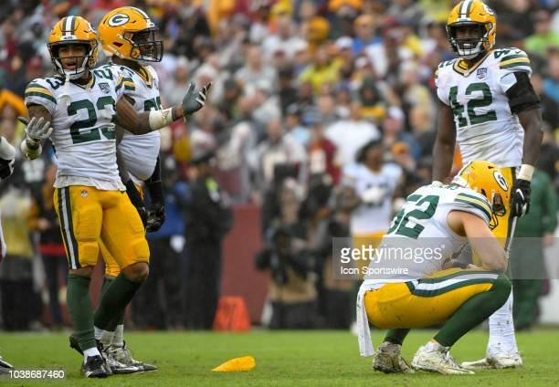 Green Bay Packers linebacker Clay Matthews and cornerback Jaire Alexander reacts after Matthews was called for a roughing the passer penalty in the...