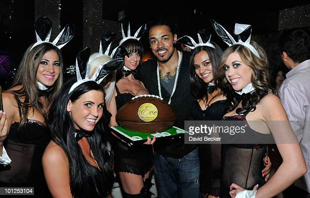 Green Bay Packers' linebacker Nick Barnett celebrates his birthday with cocktail servers during the Bunny Bash at the Eve nightclub at Crystals at...