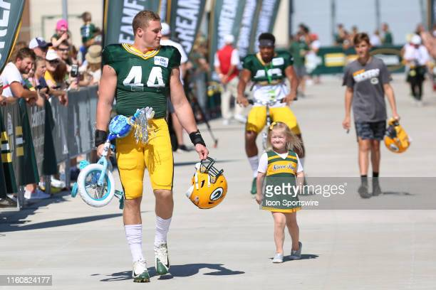 Green Bay Packers linebacker Ty Summers caries his bike kids bike during practice at Green Bay Packers Training Camp at Ray Nitschke Field on August...