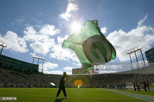 Green Bay Packers mascot waves a team flag on the field during a game against the New Orleans Saints on October 9 2005 at Lambeau Field Stadium in...
