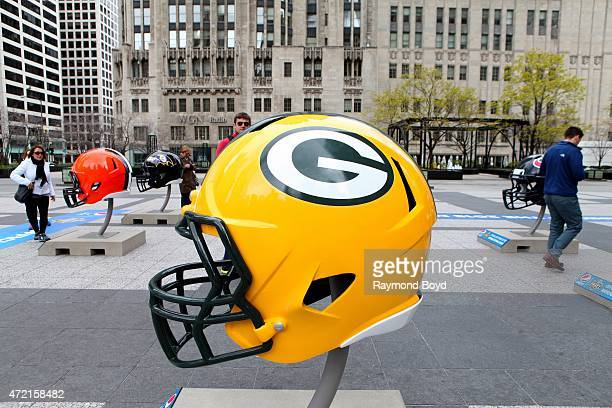 Green Bay Packers NFL football helmet is on display in Pioneer Court to commemorate the NFL Draft 2015 in Chicago on April 30 2015 in Chicago Illinois