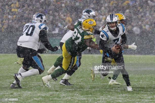 Green Bay Packers nose tackle Kenny Clark tries to slow down Carolina Panthers quarterback Kyle Allen during game between the Green Bay Packers and...