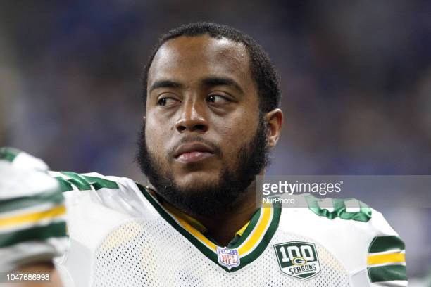Green Bay Packers offensive guard Justin McCray looks on from the sidelines during the second half of an NFL football game against the Detroit Lions...