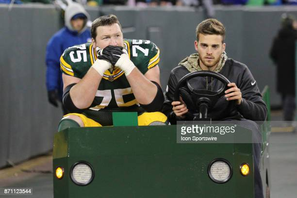 Green Bay Packers offensive tackle Bryan Bulaga is carted off the field during a game between the Green Bay Packers and the Detroit Lions on November...