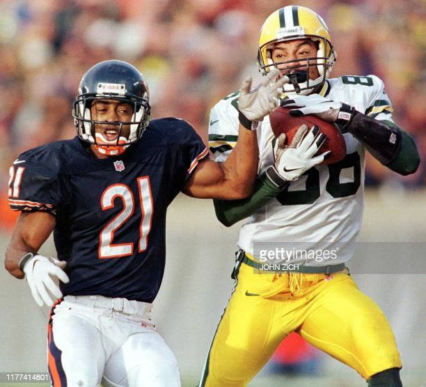 Green Bay Packers player Antonio Freeman makes a reception under coverage from Chicago Bears defender Terry Cousin in the first quarter of their game...