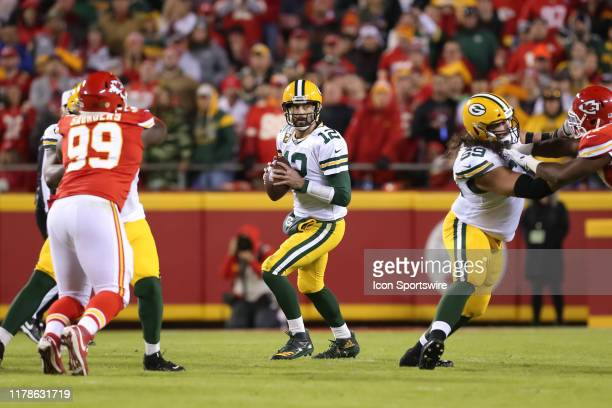 Green Bay Packers quarterback Aaron Rodgers drops back before completing a 50yard pass to Green Bay Packers running back Aaron Jones in the first...