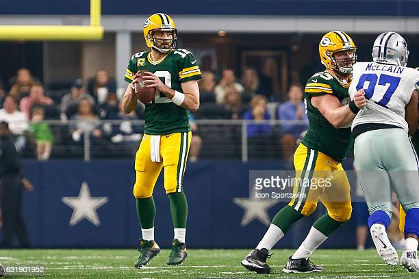 Green Bay Packers quarterback Aaron Rodgers drops back to pass during the NFC Divisional Playoff game between the Dallas Cowboys and Green Bay...
