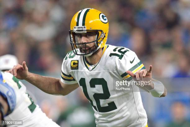 Green Bay Packers quarterback Aaron Rodgers gestures at the line before the snap during the second half of an NFL football game against the Detroit...